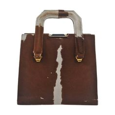 Cowhide Handbag with Bakelite Clasp | From a collection of rare vintage handbags and purses at https://www.1stdibs.com/fashion/handbags-purses-bags/handbags-purses-bags/