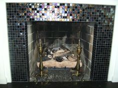 fireplace with glass tile surround