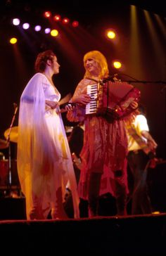 In the 70's, long skirts w/ boots = the look for bohemian babes...then  Disco music was born & 'The Hustle' co-existed at this same time of great rock