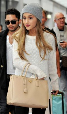 Beanies are so in, especially if Ariana Grande is rockin' them. Her hair and make up though!