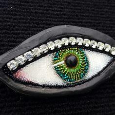 Barbara Lash beaded eye on clay