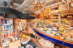 LIBRERIA ACQUA ALTA Where: Venice  Where in the world can you find a bookstore perched on a centuries-old canal? Venice, of course! With old stonewalls and books piled all over, the Libreria Acqua Alta (Calle Longa Santa Maria Formosa)