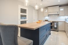 Grey and inky blue contemporary painted kitchen by Newhaven Kitchens.