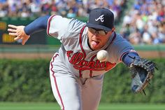 Freddie Freeman, Braves  -  The Next First-Time MLB MVP   -  November 21, 2017.  Atlanta Braves first baseman Freddie Freeman dives for a ball off the bat of Chicago Cubs catcher Miguel Montero during a game on Aug. 23, 2015, in Chicago. The Cubs won 9-3.