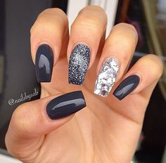 Dark grey and silver glitter nail art.