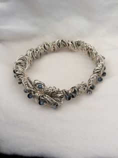 A personal favorite from my Etsy shop https://www.etsy.com/listing/234572313/woven-silver-wire-with-swarovski