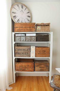 old wood boxes on white shelf