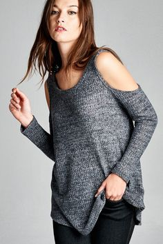 - Loose fit, long sleeve cold shoulder, round neck top. Semi rounded hems. - Model is wearing a small. - Imported - 49% Polyester, 49% Rayon, 2% Spandex