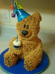 Bear cake holding a one