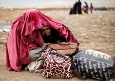 Photos of the day - January 25 2017A displaced Iraqi woman...  Photos of the day - January 25 2017  A displaced Iraqi woman covers her daughter during cold weather after fleeing the battle between Iraqi rapid response forces and Islamic State militants near Mosul Iraq; Greenpeace protesters unfurl a banner that reads Resist at the construction site of the former Washington Post building near the White House in Washington; and balloons carrying visitors fly at sunrise over old temples in the…