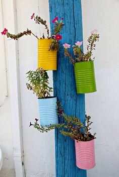 Painted cans in kardamena, kos. Greek Island garden idea