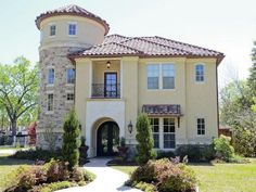 Italian style stucco & stone with tile roof (pic 1 of 2)