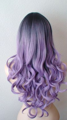 Wigs by Keke -- 2015 Color: Pastel Lavender with dark roots Hair style: Long curly hair with long side bangs Overall length: 26 Part: Circle center
