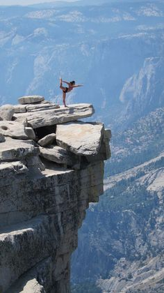 Yoga poses around the world. Here, on the top of the Half Dome (elevation 8,842 feet) at Yosemite National Park!