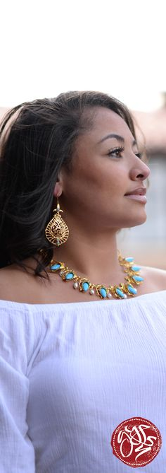 Pair these detailed gold earrings with a turquoise and gold statement necklace.