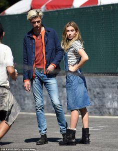 Tough job: The 19-year-old posed with fellow model Lucky Smith at famous Los Angeles landm...