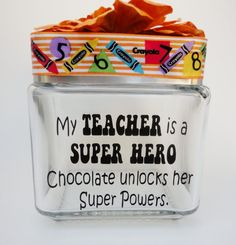 Candy jar - My TEACHER is a SUPER HERO, Chocolate unlocks her Super Powers made with premium black vinyl. A ribbon covers the edge of the lid and an