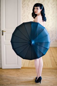 1950s Vintage Pinup Boudoir. Much smaller umbrella so that belly sticks out past it =) @Style Space & Stuff Blog @AbdulAziz Bukhamseen Home Sweet Home Blog Marie White