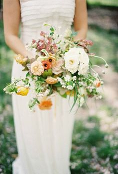 I love the idea of a loose, organic wedding bouquet that looks freshly picked from the garden! | Bouquet by Saipua via Kina Wicks Photography.