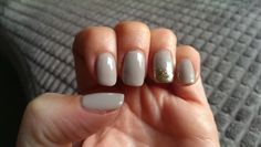 Loving my new nails - taupe/mousse with a chunky gold glitter accent LOVE!
