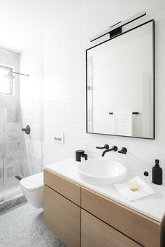 Super sleek and chic black fixtures on white finishes, | Bathroom Design Ideas
