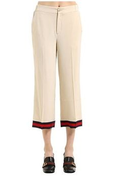 Silk Crepe De Chine Pants.  Front button and concealed zip closure, back elastic waistband and web cuff trim. Two front pleats and two side pockets. Unlined.