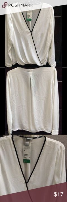 💕NWT💕 H&M Black and White Blouse Black and White blouse from H&M. Brand new, never been worn. Has a V style neck with a small decorative button, long sleeves with 2 buttons. Front of the blouse has a lining inside to prevent see thru. Tops Blouses