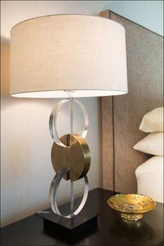 Atop the nightstands is a pair of metal and crystal lamps.