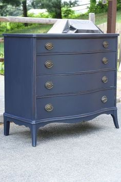 Awesome transformation of a seriously beat up dresser.  She used General Finishes Milk Paint from Rockler in Coastal Blue.  She goes into detail on the products she used to fix chips and to smooth the piece out. by kim