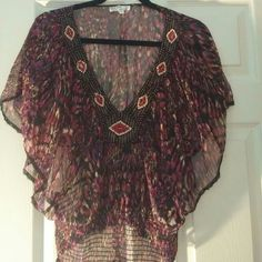 NWOT-Multi Colored Sheer Top NWOT-Multi Colored Sheer Top. Says large but looks more like a medium so I will list as a medium. Trust me in this! From besties boutique. Tops Blouses