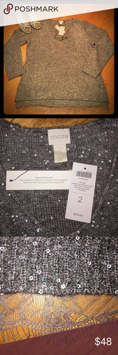 Chico's Samantha Shine Pullover Sequin Sweater NWT Chico's shiny and stunning, yet simply beautiful. Gorgeous Heather Grey Sweater. Classy lace along the bottom. New With Tags!  Originally $109. Size 2 = Medium. Chico's Sweaters Crew & Scoop Necks