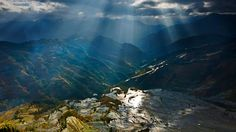 Sunlight reflecting on rice paddy terraces, Yuanyang County, China (© Eastphoto/age fotostock)
