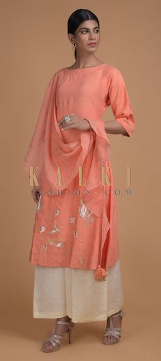 Buy Online from the link below. We ship worldwide (Free Shipping over US$100)  Click Anywhere to Tag Ravishing Coral Peach Tunic In Cotton Enhanced With Foil Printed Floral Pattern And Attached Drape Online - Kalki Fashion Ravishing coral peach tunic in cotton enhanced with foil printed floral pattern on the hemline.Designed with an attached drape in linen on the shoulder with foil printed buttis in bird motifs and tassel on the edge