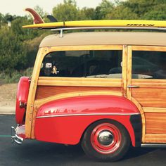 retro woody station wagon with a surfboard on top, it doesn't get any cooler than this ~