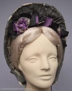 Drawn silk bonnet in checked silk with black and violet appointments.