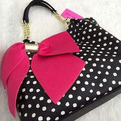 "BANANA SALE NWT Betsey Johnson Pink Bow Purse Too cute-perfect for Summer. Great for everyday or traveling. Black with white polka dots accented by a large magenta bow. Gold tone hardware and chain handles. Zippered top with two compartments. Measures 12""Hx20""Wx4""D. No Trades. TB1047. Betsey Johnson Bags Satchels"