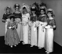 Lovely two-toned bridesmaid gowns. Bride's lace overlay over sheath gown is elegant. 1960's