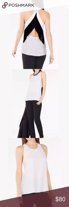 BCBG Elayne Fringe Back Top Crafted from lightweight crepe, a skin-baring open back with cascading fringe trim adds a bohemian-chic touch to this versatile top.  Back hook-and-eye closures. Self: Satin back crepe – triacetate, polyester. Trim: Fringe – rayon/poly BCBG Tops Tank Tops