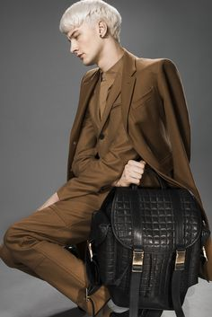 Neil Barrett backpack. Burberry London's wool coat, Richard Chai's wool, nylon and cashmere suit and Calvin Klein Collection's cotton shirt. [Photo by Rodolfo Martinez]