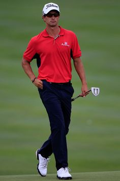 Adam Scott of Australia walks onto the 18th green during the first round of the World Golf Championships-Bridgestone Invitational on the South Course at Firestone Country Club on August 4, 2011 in Akron, Ohio.