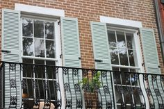 Maintaining the historical integrity of this building was essential, and these shutters do the job perfectly! Exterior Shutters, Shades Blinds, Integrity, Window Treatments, Garage Doors, Windows, Curtains, Building, Outdoor Decor