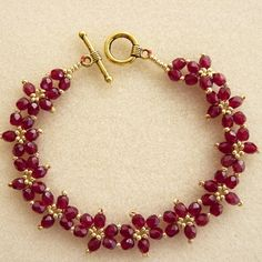 stunning garnet colour firepolish crystal daisy flower bracelet £7.00