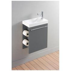 Découvrez un ensemble meuble lave-mains muni d'un distributeur de papier. Il s'installera facilement dans une petite pièce. Et tout cela à petit prix !
