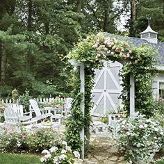 look at this lovely little space - go through the arbor and you are enclosed in your own little patio space..ahhhh