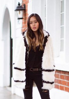 Aimee Song of Song of Style in a white fur jacket, Saint Laurent belt and distressed skinny jeans