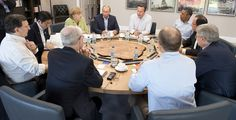 G8 Leaders, including PM David Cameron and US President Barack Obama gather around the table for a counter-terrorism working session at the G8 Summit in Northern Ireland.