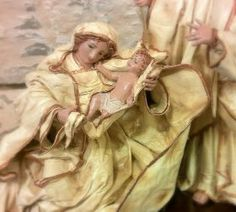 White Nativity Artwork sacred, three statues of crib in Lecce's terracotta and papier-mâché, located on the same basis only, representing St Joseph, Jesus and the Virgin Mary, wrapped in white robes. #madeinitaly #artigianato