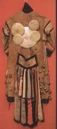 boohuyag. This is the back view of a shaman robe. Note the many mirrors attached. Shaman use mirrors for many reasons. Divination, protection, channeling energy, and capturing bad spirits are some uses