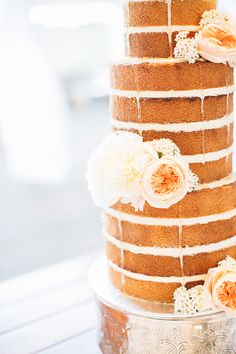 sophisticated + simple, photo by Natasja Kremers http://ruffledblog.com/sweet-western-australia-wedding #weddingcake #cakes #nakedcake