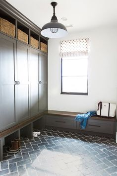 Mud room with long, narrow bench for L-shaped configuration